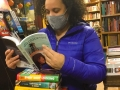 """Middle and high-school librarian Cori, looking over some of the ALA award winners 2021 and new arrivals. """"This is what happens when you haven't been to Book Beat in awhile,"""" said Cori. #readingwomen"""